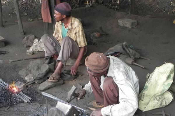 Marangu Safari - blacksmiths reshaping scrap metal