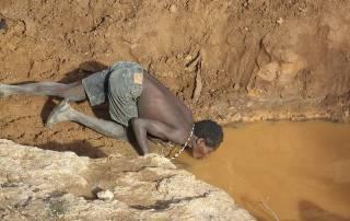 Drinking Muddy Water, Hadzabe, Lake Eyasi Safari