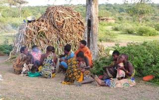Hadzabe Women at their grass hut home, Lake Eyasi Safari.