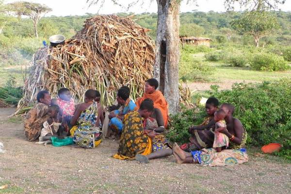 Hadzabe Women Morning Fire at Their Grass Hut, Lake Eyasi Safari