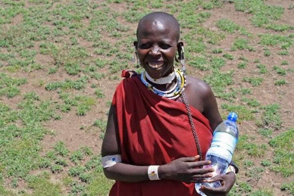 Happy Maasai Herder, with Water Gift, Olduvai Gorge Safari