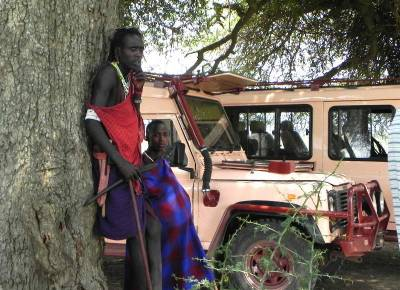 Maasai Warrior with Lion Club and Cell Phone
