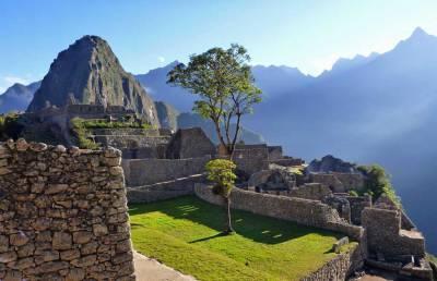 Visit Machu Picchu in front of Huayna Picchu