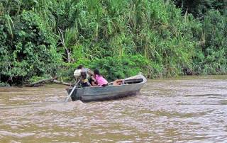 Children Navigating the Tambopata River