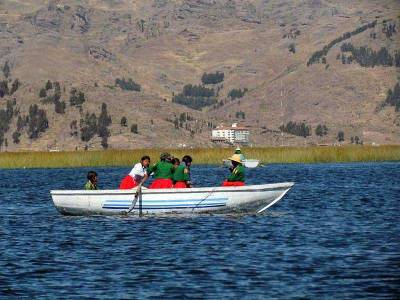 Children Rowing Home from School, Lake Titicaca, Uros Islands Tour