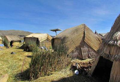 Solar Panel and Reed Shelters, Uros Islands Tour