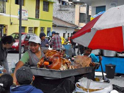 Street Vendor Selling Pork from Cooked Pig with Head On, Visit Quito