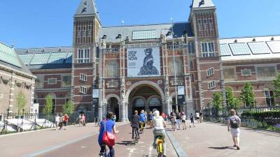Bike straight through Rijksmuseum, Visit Amsterdam